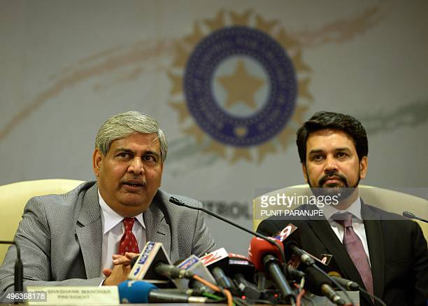 Board of Control for Cricket in India President Shashank Manohar speaks as BCCI Secretary Anurag Thakur looks on during a news conference at the...