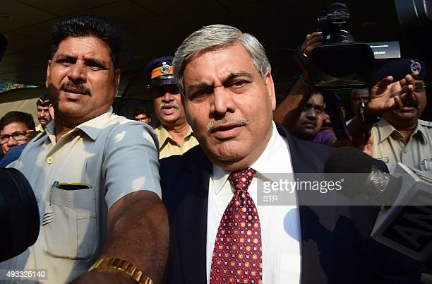 Board of Control for Cricket in India president Shashank Manohar is escorted out of the Indian cricket board's headquarters at the Wankhede stadium...