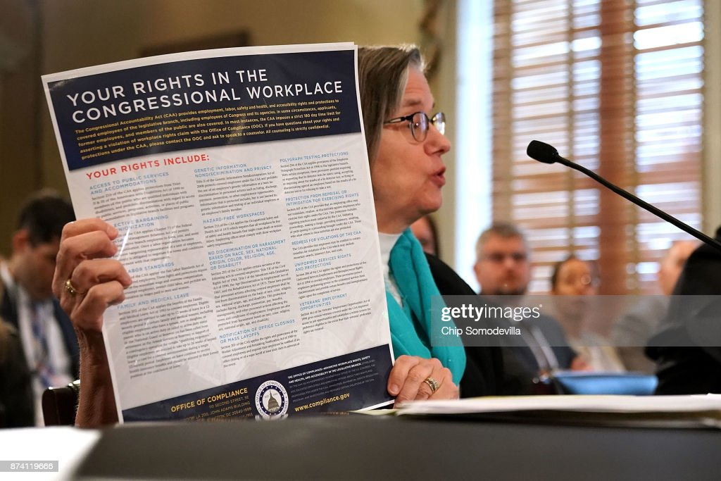 Board of Directors for the Office of Compliance Chair Barbara Childs Wallace holds up a poster titled 'Your Rights in the Congressional Workplace' while testifying before the House Administration Committee in the Longworth House Office Building on Capitol Hill November 14, 2017 in Washington, DC. In the wake of recent high-profile accusations of sexual assult and harassment by powerful people in politics, arts, publishing, journalism and other areas, the committee recieved testimony about the need for manditory education and increased compliance to prevent sexual harassment in the Congressional workplace.