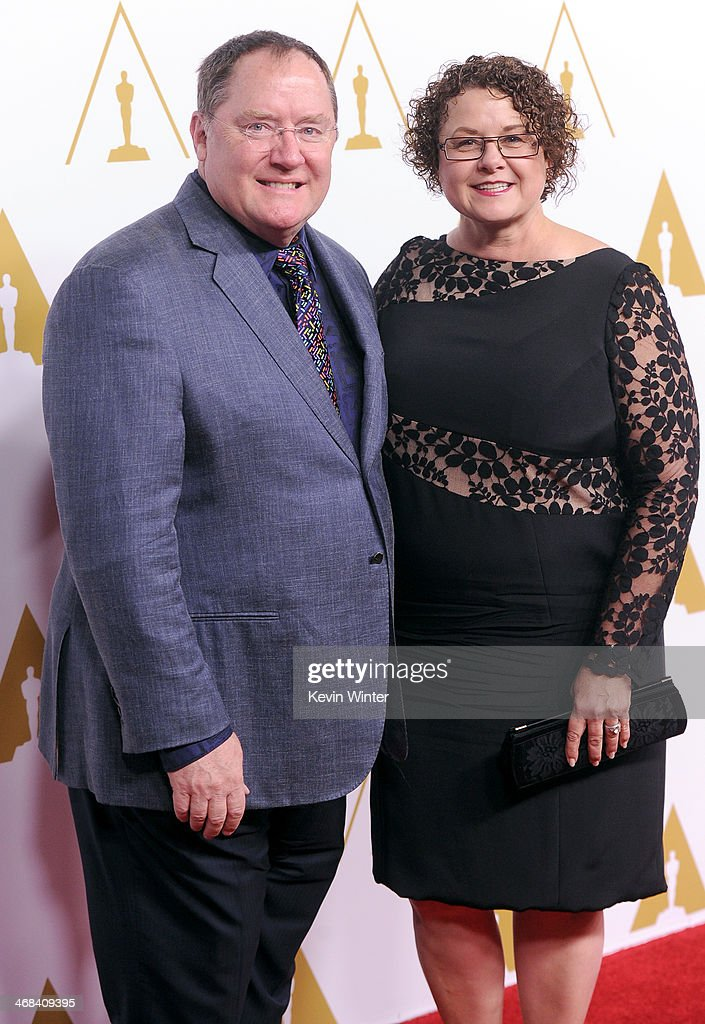 Board of Governors First Vice President - Short Films and Feature Animation Branch <a gi-track='captionPersonalityLinkClicked' href=/galleries/search?phrase=John+Lasseter&family=editorial&specificpeople=224003 ng-click='$event.stopPropagation()'>John Lasseter</a> (L) and Nancy Lasseter attend the 86th Academy Awards nominee luncheon at The Beverly Hilton Hotel on February 10, 2014 in Beverly Hills, California.