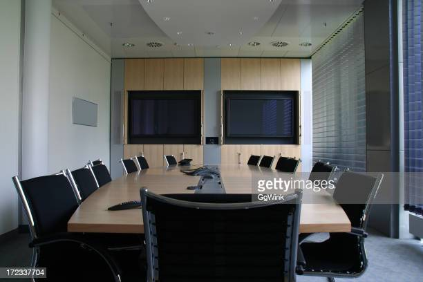 Board room with video conferencing and monitors