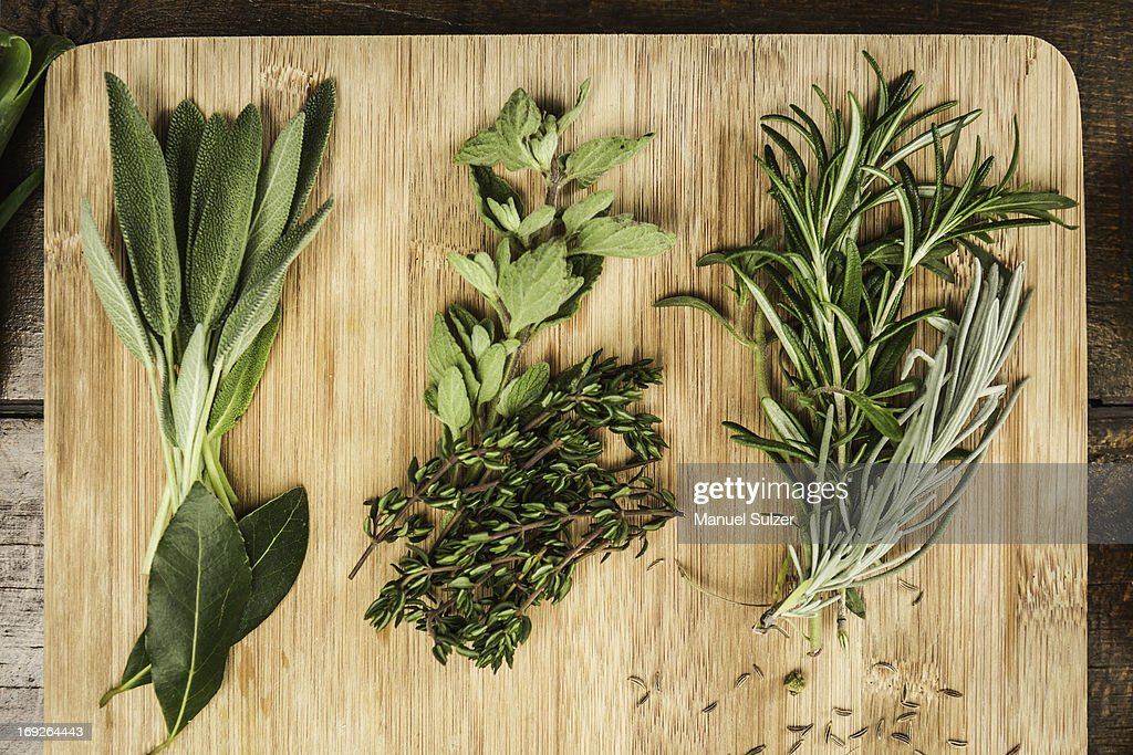 Board with whole leaf herbs