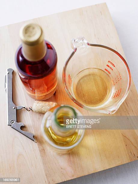 Board with wine, oil and corkscrew
