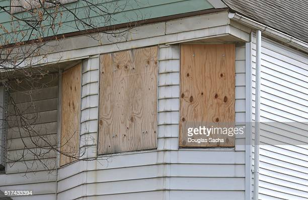 Boarded Up Windows in a residential home