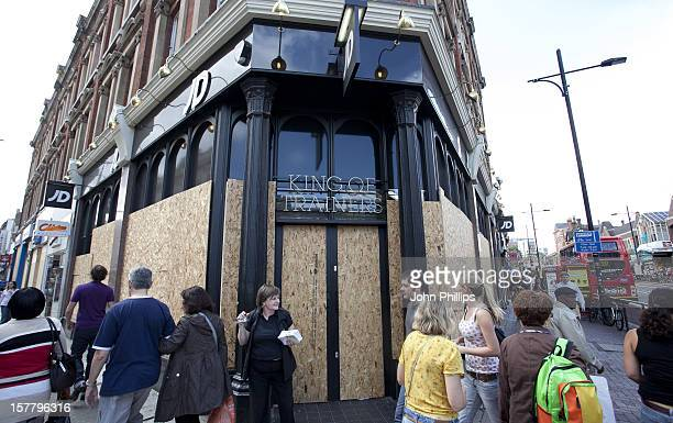Boarded Up Windows Of Shops In Clapham London