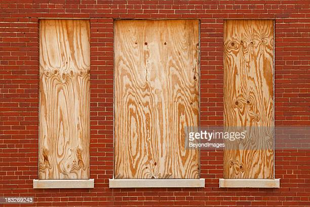 Boarded windows in abandoned building