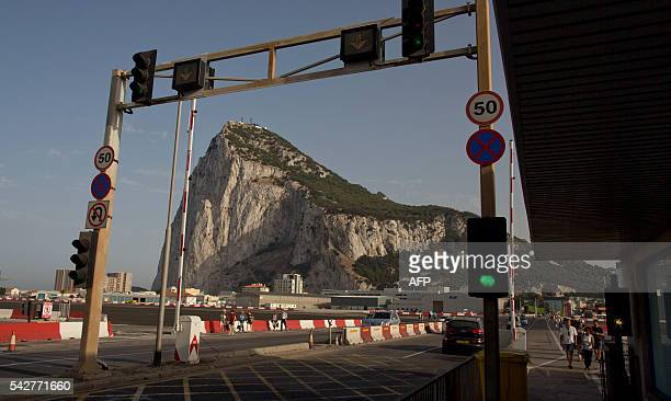 A boarder post is pictured backdropped by the 'Rock' in Gibraltar on June 24 2016 Spain said on June 24 2016 it was closer to asserting control over...