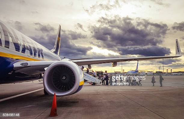 Boarding a Ryanair flight at sunset