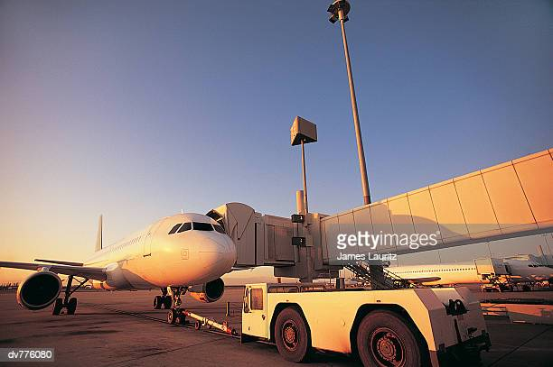 Boarding Bridges Attached to Aeroplanes on a Runway