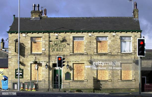 Boarding replaces windows of the Second West pub in the Liggett Green area of Bradford the morning after hundreds of youths ran amok in the night...