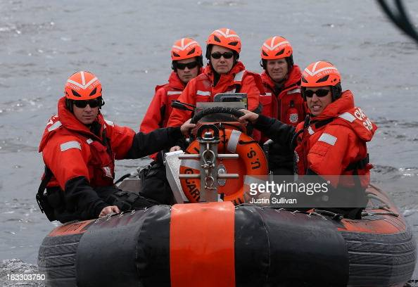 A boarding team from the US Coast Guard Cutter Hawksbill returns to the boat after boarding a fishing vessel while on patrol in the Pacific Ocean off...