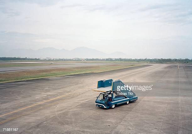 Boarding vehicle on airport runway
