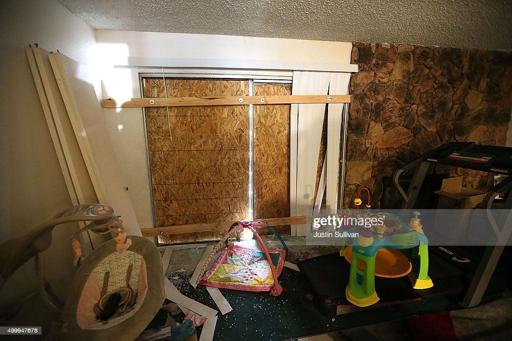 Boards block the windows inside the home of shooting suspect Syed Farook on December 4 2015 in Redlands California The San Bernardino community is...