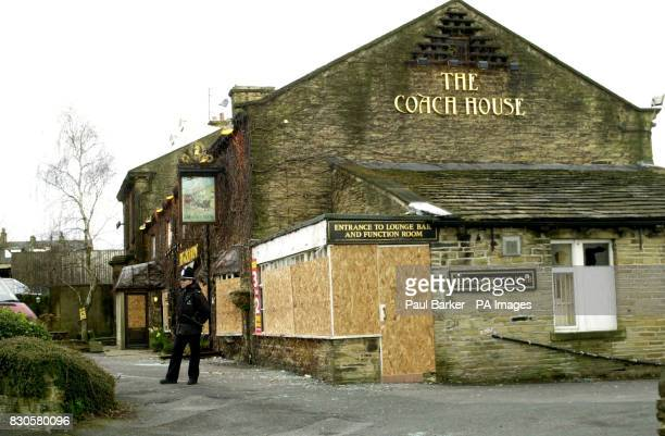 Boards replace broken windows of the Coach House pub in the Liggett Green area of Bradford the morning after hundreds of youths ran amok in the night...