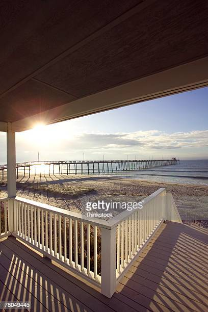 Boardwalk and shelter overlooking beach and pier