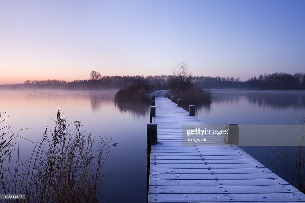 Boardwalk on a lake at dawn in winter, The Netherlands : Stock Photo
