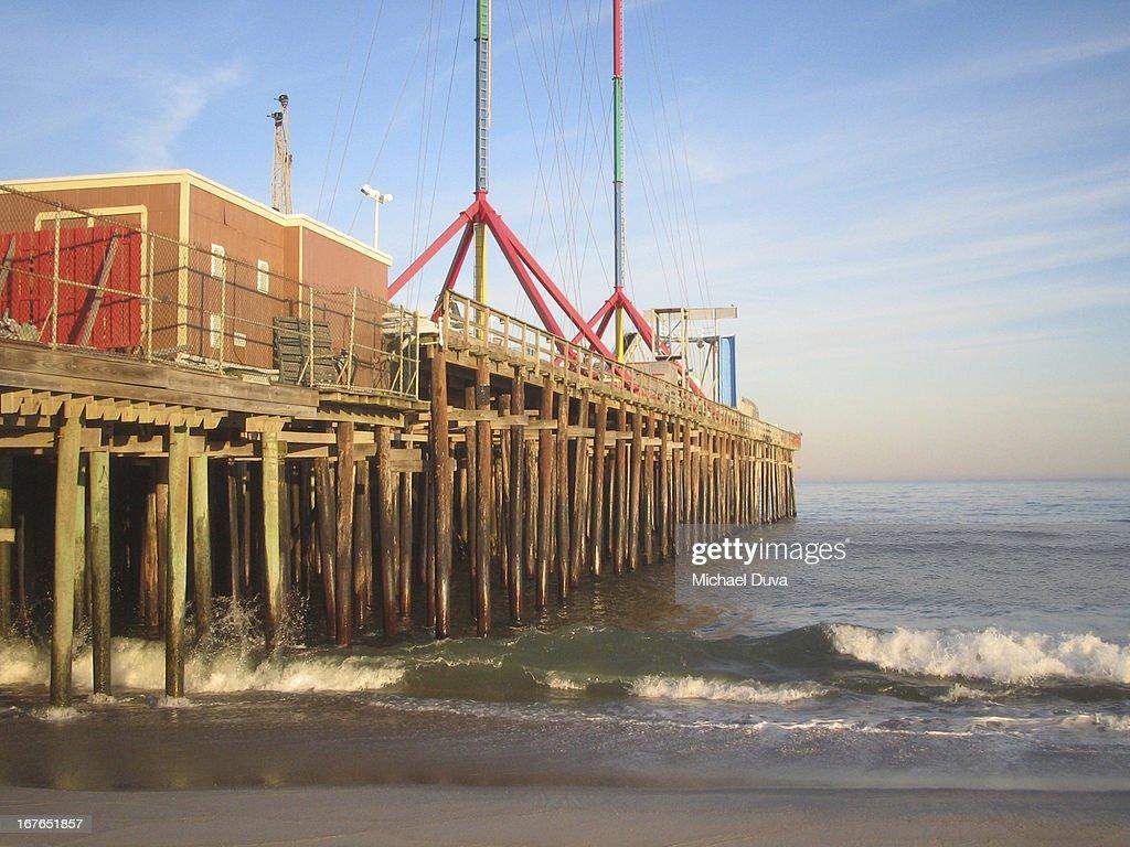 Boardwalk pilings for amusement pier seaside stock photo for Pier piling