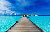 A boardwalk leads to an island in the Maldives