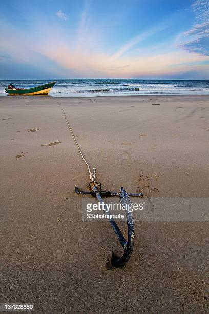 Boat anchored by  beach