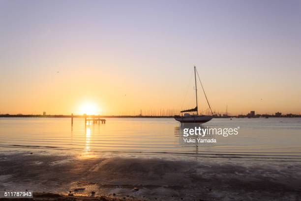 A boat and sunset at St. Kilda Pier in Melbourne
