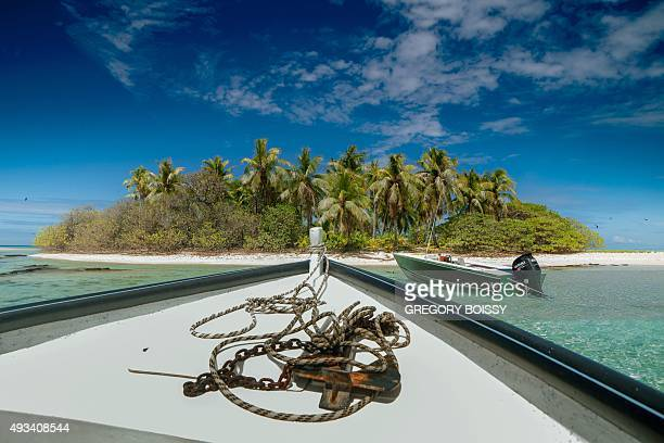 A boat approaches the Tagoi motu near the Toau atoll about 400 kilometres from Tahiti in the Tuamotu Archipelago in the French polynesia on October...