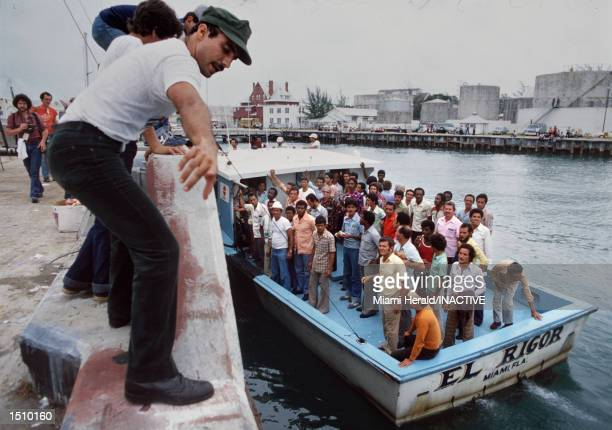 A boat arrives in Key West Florida with more Cuban refugees April 1980 from Mariel Harbor after crossing the Florida Straits This is the 20th...