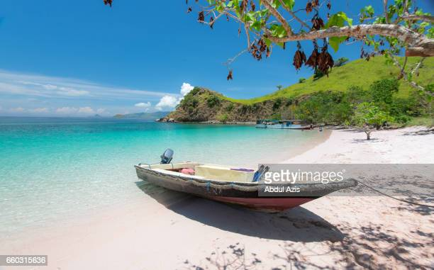 Boat at Pink Beach - The most beautiful beach in  Komodo National Park - Labuan Bajo in Flores Island- East Nusa Tenggara - Indonesia