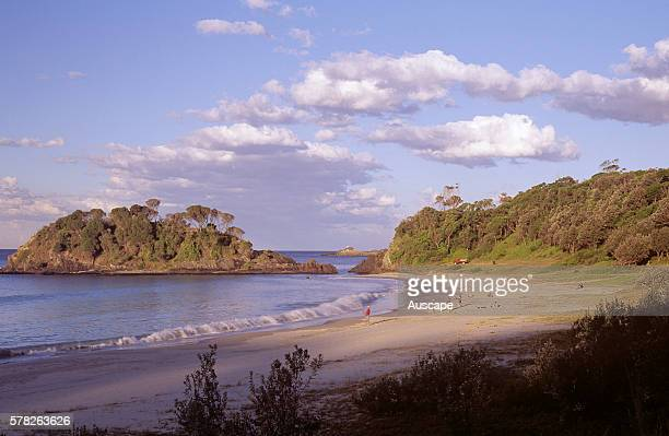 Boat Beach in Sugarloaf Bay with Statis Rock and beach fishermen Seal Rocks Great Lakes area New South Wales Australia