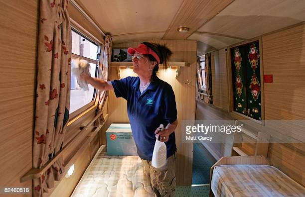 Boat builder Jane Chalker cleans the inside of a finished narrowboat as her company ABC Leisure Group prepare it for service as a canal holiday hire...