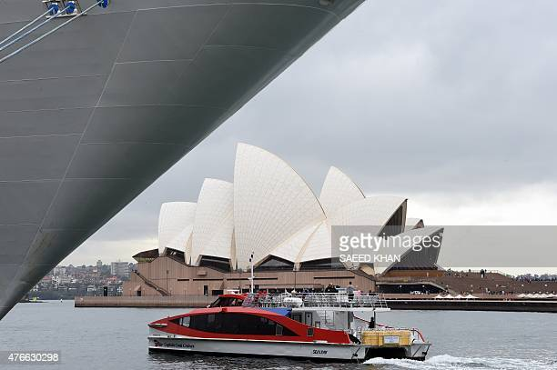 A boat carries tourists in front of the Sydney's landmark Opera House on June 11 2015 Australia's unemployment rate fell to 60 percent in May...