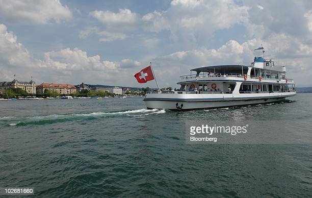 A boat carries tourists on Lake Zurich in Zurich Switzerland on Tuesday July 6 2010 Companies relocating to Switzerland negotiate through accounting...