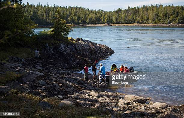 A boat carrying protesters and supplies lands on Lelu Island near Prince Rupert British Columbia Canada on Wednesday Aug 24 2016 Facing five major...