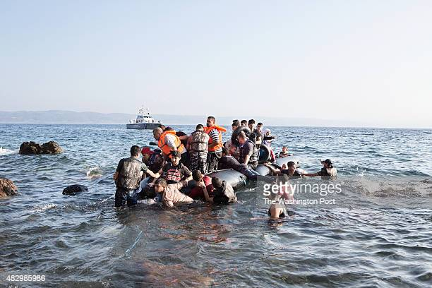 A boat carrying Syrian refugees lands on August 2 2015 near Molyvos on the island of Lesvos Greece