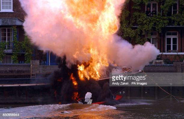 A boat crashes into a barge and explodes during the filming of 'Charlie' along the River Thames London The film stars Luke Goss formerly of the pop...