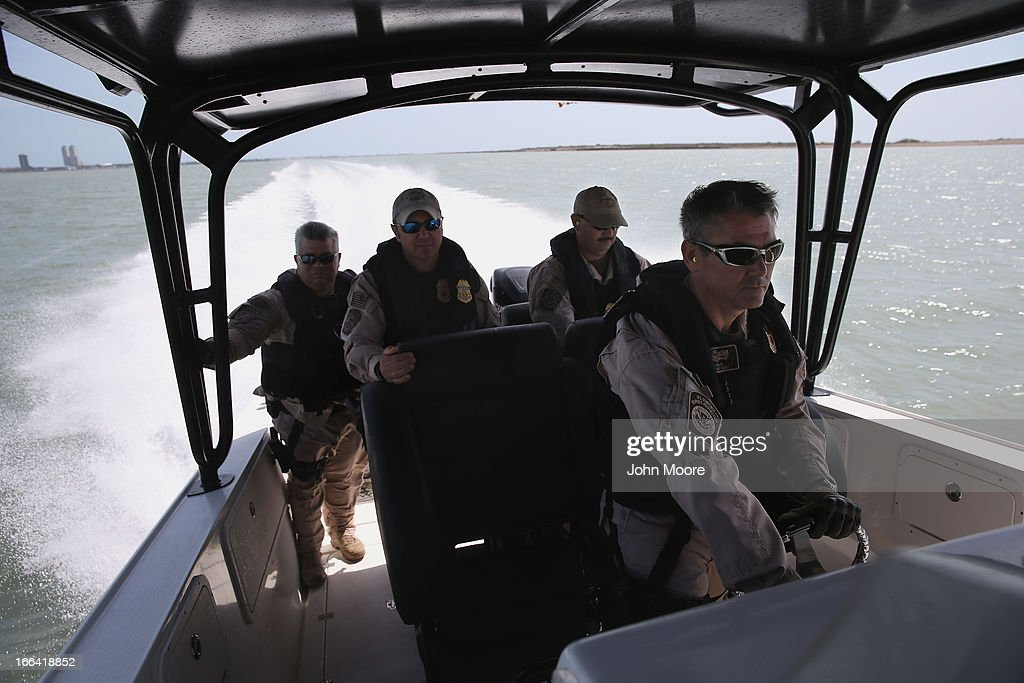 A boat crew from the U.S. Office of Air and Marine (OAM) races through the waters of the Gulf of Mexico while on a patrol on April 12, 2013 near Port Isabel, Texas. The marine unit patrols coastline waters near the U.S.-Mexico border searching for drug smugglers as well as illegal immigrants, which come across from Mexico near the mouth of the Rio Grande River. Vehicle commander P.J. Welch led a crew on the Midnight Express interceptor, a 39 foot 900 horsepower craft capable of chasing smugglers down at 55 knots (63 mph). OAM units also push back illegal fishing boats out of U.S. waters.