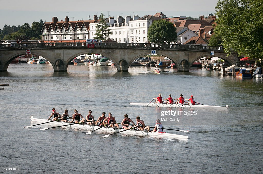 A boat crew prepares to competes in a race at the Henley Royal Regatta on July 3, 2014 in Henley-on-Thames, England. Opening today and celebrating its 175th year, the Henley Royal Regatta is regarded as part of the English social season and is held annually over five days on the River Thames. Thousands of rowing fans are expected to come to watch races which are head-to-head knock out competitions, raced over a course of 1 mile, 550 yards (2,112 m) which regularly attracts international crews to race.