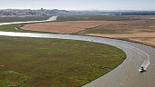 A boat cruises the Petaluma River as viewed from the air on June 22 over Petaluma California Growth has become a major political and social issue in...