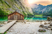 Beautiful landscape with wooden boathouse on the mountain lake in Bavarian Alps, Obersee, Berchtesgaden, Germany, Europe