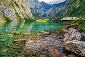 Wooden boathouse on the clean mountain lake in Bavarian Alps,Obersee,Berchtesgaden,Germany,Europe