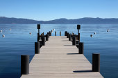 boat dock pier out to lake Tahoe and mounatins