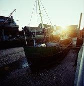 Boat docked at dry pier