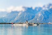Boat floating in Geneva  lake in Switzerland. Miniature tilt shift lens effect.