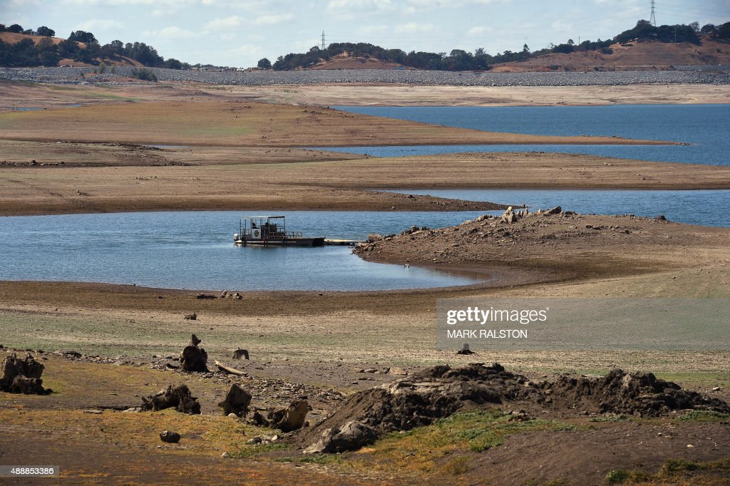 A boat floats in Folsom Lake reservoir near Sacramento standing at only 18 percent capacity as the severe drought continues in California on...