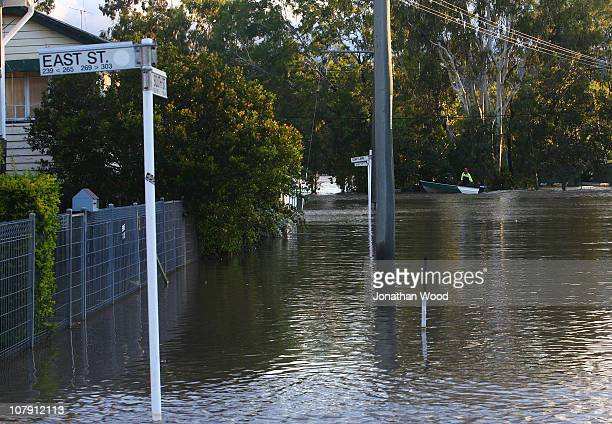 A boat floats through a residential street on January 7 2011 in Rockhampton Australia Floodwaters peaked at 92 metres two days ago in the central...