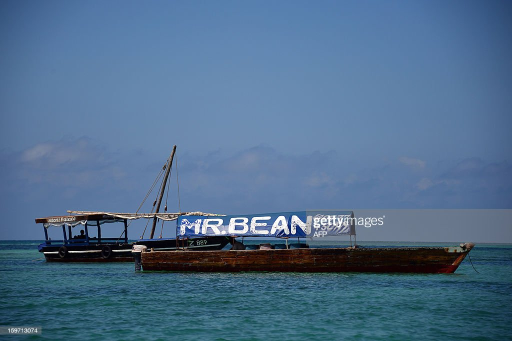 A boat for tourists dispalys an banner reading 'Mr Bean' and a telephone number on January 9, 2013 in Zanzibar.