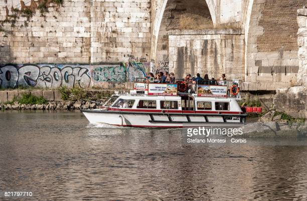 A boat for tourists sailing on the Tiber River with the low water level due to the drought on July 24 2017 in Rome Italy Because of the drought the...