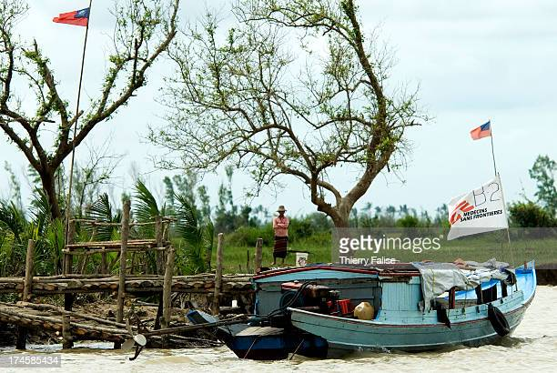 A boat from a Médecins Sans Frontières team is anchored at the jetty of a village destroyed by cyclone Nargis According to official figures the...