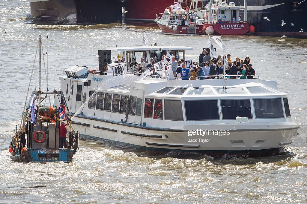 A boat from the 'Fishing for Leave' campaign group sprays a boat from the 'In' campaign with water during a flotilla along the Thames River on June 15, 2016 in London, England. The flotilla organised by members of the Fishing for Leave group, who are campaigning to leave the European Union ahead of the referendum on the 23rd of June, was countered by boats representing the 'In' campaign.