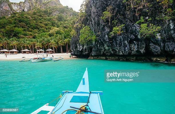 Boat heading to tropical beach in El Nido, Palawan