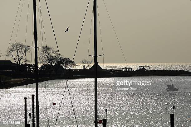 A boat heads out into Long Island Sound during an afternoon of warm and sunny weather on December 13 2015 in Fairfield Connecticut Temperatures...